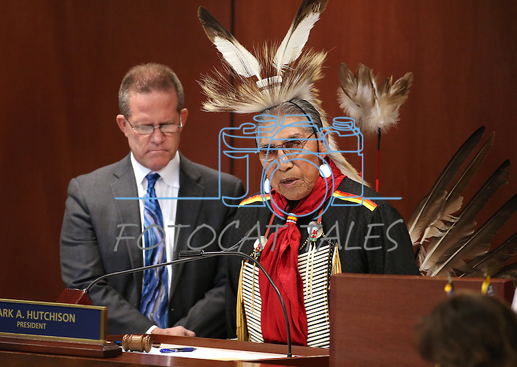 Lt. Gov. Mark Hutchison, left, listens as Paiute Tribal Elder Ralph Burns leads the Senate in prayer as part of Nevada Tribes Day at the Legislative Building in Carson City, Nev., on Tuesday, Feb. 10, 2015. <br /> Photo by Cathleen Allison