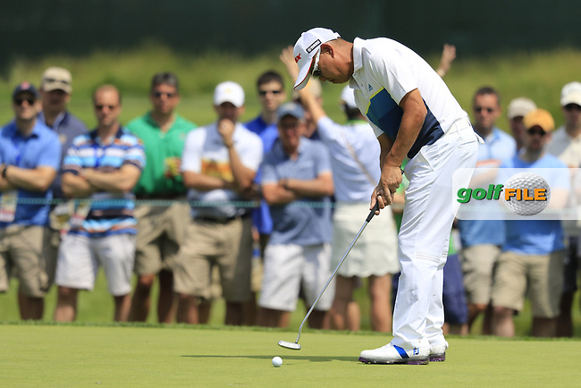 Toru Taniguchi (JPN) takes his putt on the 10th green during Friday's Round 1 of the 2016 U.S. Open Championship held at Oakmont Country Club, Oakmont, Pittsburgh, Pennsylvania, United States of America. 17th June 2016.<br /> Picture: Eoin Clarke | Golffile<br /> <br /> <br /> All photos usage must carry mandatory copyright credit (&copy; Golffile | Eoin Clarke)