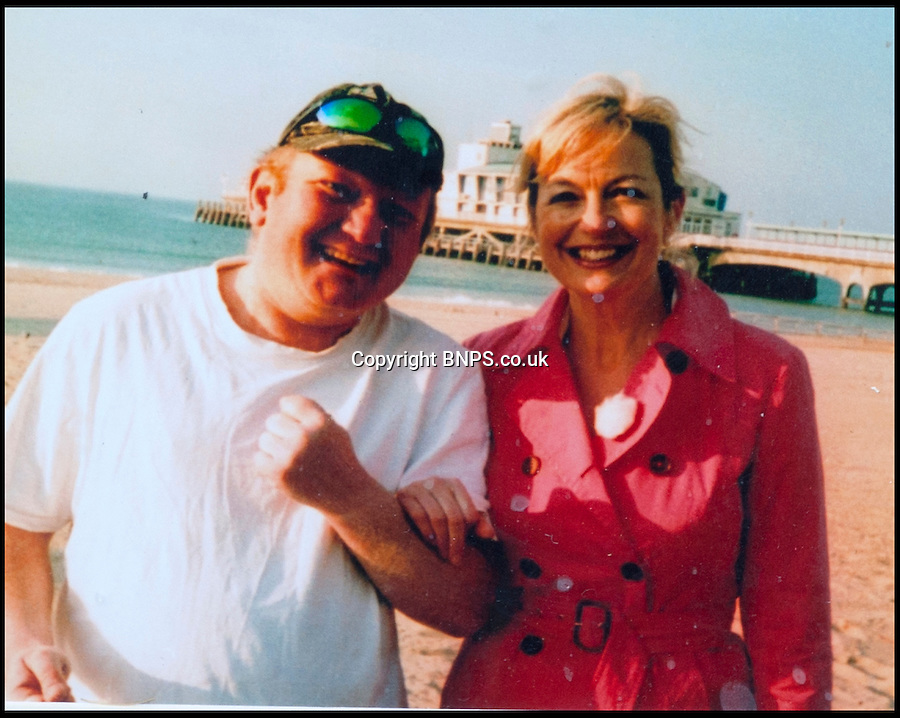 BNPS.co.uk (01202) 558833<br /> Picture: Collect/BNPS<br /> <br /> Andrew Young who is with BBC weather presenter Carol Kirkwood at Bournemouth Beach, Dorset.<br /> <br /> Andrew Young, 40, became embroiled in an argument with Victor Ibitoye after he blasted him for riding his bike on the pavement.