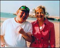 BNPS.co.uk (01202) 558833<br /> Picture: Collect/BNPS<br /> <br /> Andrew Young who is with BBC weather presenter Carol Kirkwood at Bournemouth Beach, Dorset.<br /> <br /> Andrew Young, 40, became embroiled in an argument with Victor Ibitoye after he blasted him for riding his bike on the pavement.Just seconds after the altercation Mr Young was approached by Mr Ibitoye's friend, Lewis Gill, who launched a horrific attack on the Asperger's Syndrome sufferer.Shocking CCTV footage shows Gill, aged 20, throw a punch at Mr Young that was so forceful he was flung off the pavement and onto the road, striking his head.The callous thug is then seen walking away from the man as he lay lifeless on the ground.He was rushed from the scene in Bournemouth, Dorset, to Southampton General Hospital in Hampshire where he died the next day.A post mortem found no injuries to suggest that the vulnerable victim had tried to defend himself.Gill pleaded guilty to one count of manslaughter at Salisbury Crown Court and was jailed for four years and six months.