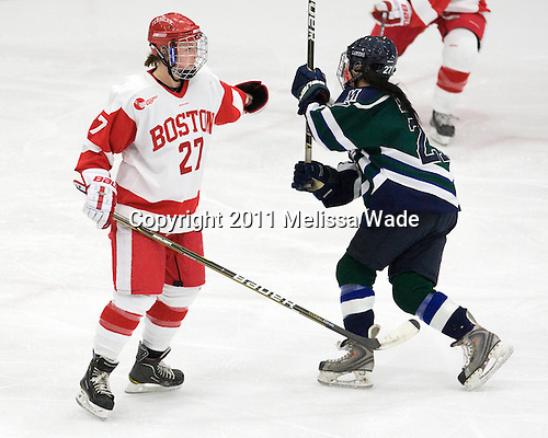 Tara Watchorn (BU - 27), Christine Bestland (Mercyhurst - 27) - The Boston University Terriers defeated the visiting Mercyhurst College Lakers 4-2 in their NCAA Quarterfinal matchup on Saturday, March 12, 2011, at Walter Brown Arena in Boston, Massachusetts.