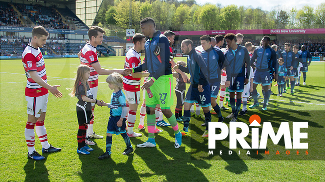Players shake hands before the Sky Bet League 2 match between Wycombe Wanderers and Doncaster Rovers at Adams Park, High Wycombe, England on 22 April 2017. Photo by James Williamson / PRiME Media Images.