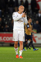 Jonjo Shelvey of Swansea greets home supporters after the Barclays Premier League match between Swansea City and Arsenal at the Liberty Stadium, Swansea on October 31st 2015