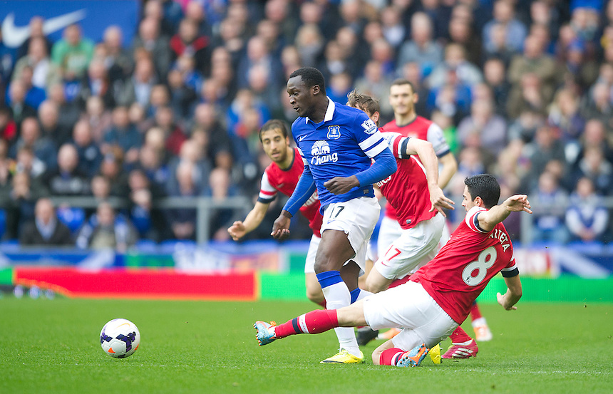 Everton's Romelu Lukaku avoids the challenge from Arsenal's Mikel Arteta<br /> <br /> Photo by Stephen White/CameraSport<br /> <br /> Football - Barclays Premiership - Everton v Arsenal - Sunday 6th April 2014 - Goodison Park - Liverpool<br /> <br /> &copy; CameraSport - 43 Linden Ave. Countesthorpe. Leicester. England. LE8 5PG - Tel: +44 (0) 116 277 4147 - admin@camerasport.com - www.camerasport.com
