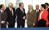 Palestinian Leader Yassir Arafat is welcomed to a meeting with United States Senators by United States Senator Joseph I. Lieberman (Democrat of Connecticut) in Washington, DC on March 4, 1997.  (L-R) United States Senator Paul Wellstone (Democrat of Minnesota), United States Senator Frank Lautenberg (Democrat of New Jersey), Senator Lieberman, Chairman Arafat, Palestinian Representative to the United States Hassan Rahman, and Palestinian Cabinet member Hanan Ashrawi.<br /> Credit: Ron Sachs / CNP