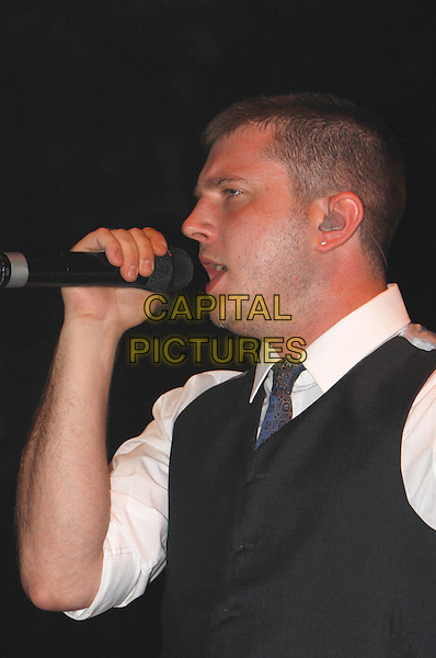 PLAN B - BEN DREW .Performing live at Wireless Festival 2010, Hyde Park, London, England, UK, July 2nd 2010..concert gig music on stage half length microphone  grey gray waistcoat white shirt tie blue side singing profile .CAP/MAR.© Martin Harris/Capital Pictures.