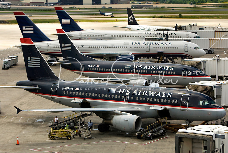 Five US Airways planes sit at the gate at Charlotte-Douglas International Airport...Charlotte-Douglas International Airport, one of US Airways' largest hubs, serves 10 major airlines, including Air Canada, Air Tran, American, Continental, Delta, JetBlue, Lufthansa, Northwest and United. The airport is the nation?s 10th largest in terms of total operations, the 18th largest in terms of total passengers and the 37th largest in terms of cargo. Charlotte-Douglas serves 640 daily flights, including direct flights to 120 cities. ..Photographer has series of images from Charlotte-Douglas International Airport, including aerials. ... PATRICK SCHNEIDER PHOTO.COM