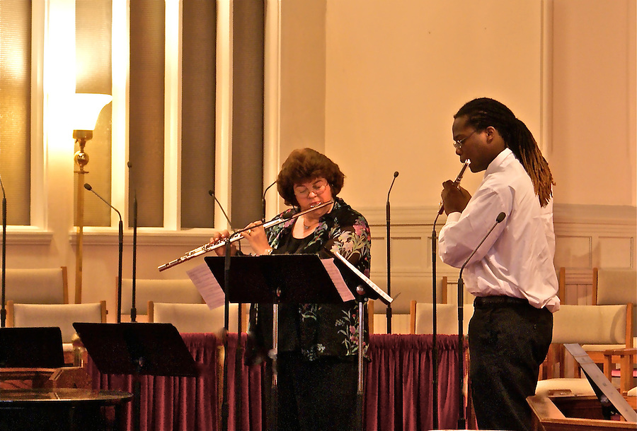 A teacher and student at a woodwind duet recital in Bridgeton, New Jersey