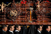 The wooden throne with fine carvings and sculptures is carried on the shoulders of the carriers during the Easter celebration in Malaga, Spain, 5 April 2007.