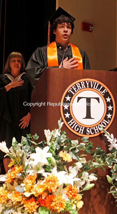 """Terryville, CT-061814MK03 Terryville High School's class 2014 Jonathan Zalaski sings the """"The Star Spangled Banner"""" during commencement exercises on Wednesday evening.  One-hundred and nineteen graduates received diplomas. Michael Kabelka / Republican-American"""
