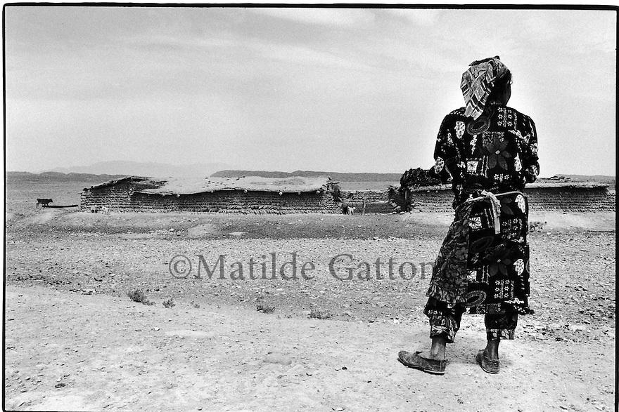 Uzbekistan - Ferghana Valley - Beduin woman watching her sheep in the farm.