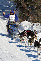 Musher Robert Nelson on Long Lake at the Re-Start of the 2011 Iditarod Sled Dog Race in Willow, Alaska.