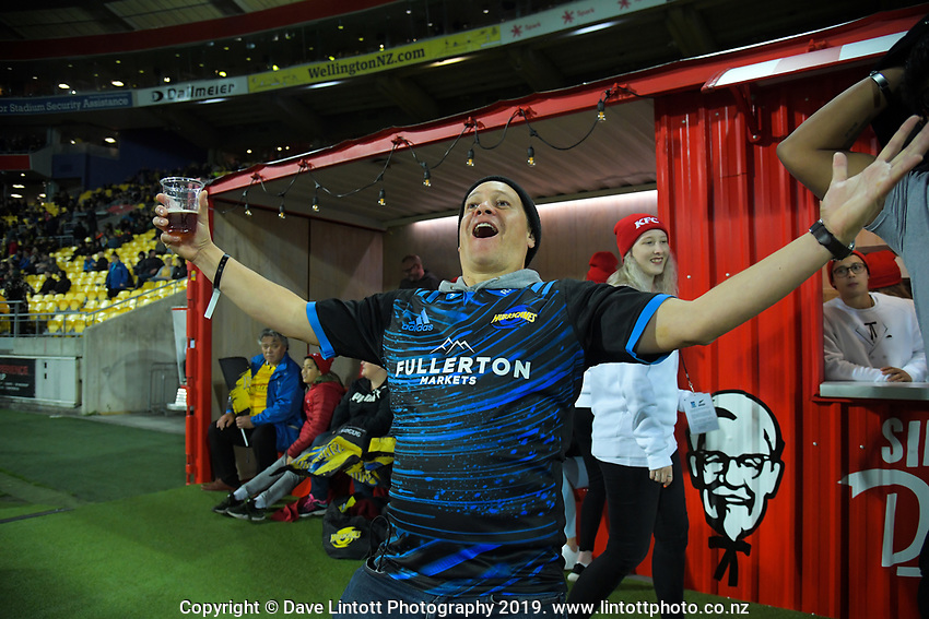 Hurricanes fan Jim Locke celebrates during the Super Rugby match between the Hurricanes and Chiefs at Westpac Stadium in Wellington, New Zealand on Friday, 27 April 2019. Photo: Dave Lintott / lintottphoto.co.nz