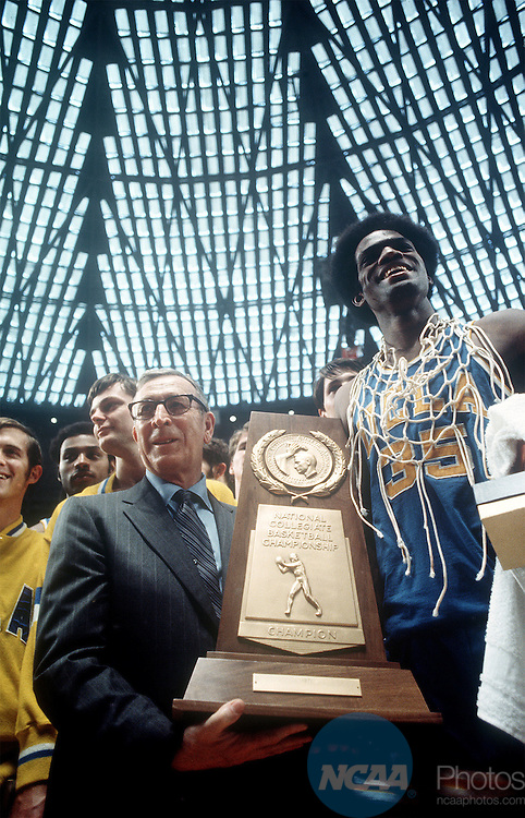 1971: UCLA coach John Wooden poses with Sidney Wicks, a starter on three Bruin championship teams, following UCLA's 68-62 victory over Villanova. The 1971 Final Four championship was held in Houston, TX. ©Rich Clarkson.