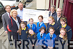 Lester Arnopp of Tralee Presentation School parents association presenting a cheque for EUR490.80 to Ted Moynihan of Kerry Hospice which was raised by an Easter Egg raffle at the school, in picture at back from left are Pat Sayers, Principal, Nancy Keane, Resource Teacher, Ted Moynihan and John Fitzpatrick, In front are students Mry Fitzpatrick, Chloe Fitzpatrick, Caoimhe O'Sullivan, Alice Jager, Holly Arnopp, Chloe Sugerue, Sinead Lynch, Megan Arnopp and Aislinn Ringland.