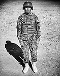 Sergeant Khand Agha, of the Afghan National Army, is seen at the Regional Military Training Centre in helmand, 12 November 2012. This portrait was shot on a 5x4 Linhof Technika IV, circa 1959, and a Voigtlander Braunschweig Heliar 15cm lens, circa 1922. (John D McHugh)