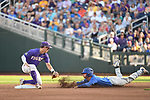 OMAHA, NE - JUNE 26: Dalton Guthrie (5) of the University of Florida dives toward second base before being tagged by Cole Freeman (8) of Louisiana State University during the Division I Men's Baseball Championship held at TD Ameritrade Park on June 26, 2017 in Omaha, Nebraska. The University of Florida defeated Louisiana State University 4-3 in game one of the best of three series. (Photo by Justin Tafoya/NCAA Photos via Getty Images)