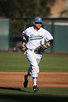 Eric Filia (4) of the UCLA Bruins returns to the dugout during a game against the North Carolina Tar Heels at Jackie Robinson Stadium on February 20, 2016 in Los Angeles, California. UCLA defeated North Carolina, 6-5. (Larry Goren/Four Seam Images)