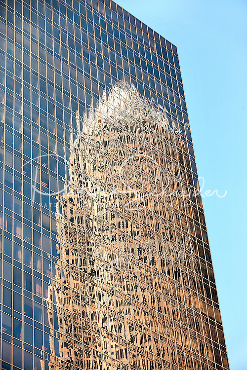 Street scenes in downtown Charlotte, NC. Here, the  Bank of America tower reflects in the glass of a nearby tower.