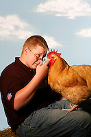 (7 FairKids Joy Falkenberg 08.03.06)  Tylor Murray (cq), 16 poses at The Ohio State Fair.  He was holding his Buff Orpington Rooster, which he will be showing at the fair.  He is from West Liberty, Ohio.  Photo to go with NOW! package on kids at the Fair.  (Columbus Dispatch Photo by Barth Falkenberg)