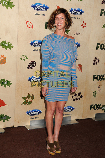 Katie Jacobs.7th Annual Fox Fall Eco-Casino Party held at The Bookbindery, Culver City, California, USA..September 12th, 2011.full length dress blue stripe off the shoulder pink knitted stripe.CAP/ADM/BP.©Byron Purvis/AdMedia/Capital Pictures.