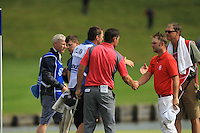 Padraig Harrington (IRL) and Andy Sullivan (ENG) finish on the 18th green during Round 2 of the 100th Open de France, played at Le Golf National, Guyancourt, Paris, France. 01/07/2016. <br /> Picture: Thos Caffrey | Golffile<br /> <br /> All photos usage must carry mandatory copyright credit   (&copy; Golffile | Thos Caffrey)