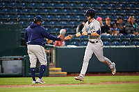 Corpus Christi Hooks manager Rodney Linares (left) congratulates right fielder Kyle Tucker (12) after hitting a home run during a game against the Springfield Cardinals on May 31, 2017 at Hammons Field in Springfield, Missouri.  Springfield defeated Corpus Christi 5-4.  (Mike Janes/Four Seam Images)