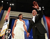 Washington, DC - January 20, 2009 -- United States President Barack Obama waves as he and his wife Michelle arrive at the Obama Homes States Ball, one of ten official inaugural balls January 20, 2009 in Washington DC.  Obama was sworn in as the 44th President of the United States today, becoming the first African-American to be elected to the presidency.  .Credit: Mark Wilson - Pool via CNP