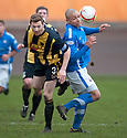Berwick's Damian Gielty and Montrose's Leighton McIntosh challenge for the ball.