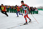 11 MAR 2011: Christian Otto (28) of the University of New Mexico is cheered on by coaches during the men's 20km Classical Cross Country races at the 2011 NCAA Men and Women's Division I Skiing Championship held Stowe Mountain Resort and Trapp Family Lodge in Stowe, VT. Otto placed 12th. ©Brett Wilhelm/NCAA Photos