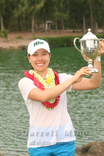 February 18, 2006; Kahuku, HI - Joo Mi Kim raises her trophy during the awards ceremony after winning the LPGA SBS Open at Turtle Bay Resort...Mandatory photo credit: Darrell Miho.© Darrell Miho