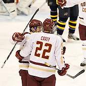 Johnny Gaudreau (BC - 13), Paul Carey (BC - 22) - The Boston College Eagles defeated the Merrimack College Warriors 4-2 to give Head Coach Jerry York his 900th collegiate win on Friday, February 17, 2012, at Kelley Rink at Conte Forum in Chestnut Hill, Massachusetts.
