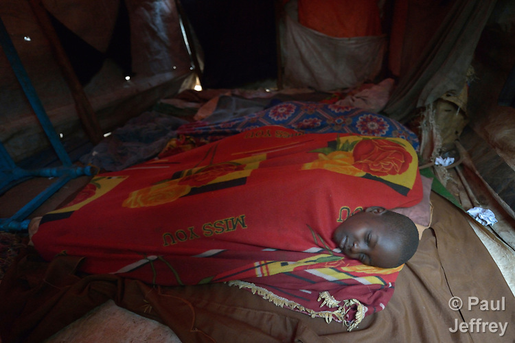 A boy and his siblings asleep in their makeshift shelter in a camp for more than 12,000 internally displaced persons located on the grounds of the Roman Catholic Cathedral of St. Mary in Wau, South Sudan. Most of the families here were displaced in June, 2016, when armed conflict engulfed Wau.<br /> <br /> Norwegian Church Aid, a member of the ACT Alliance, has provided relief supplies to the displaced in Wau, and has supported the South Sudan Council of Churches as it has struggled to mediate the conflict in Wau.