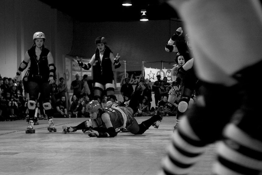 "San Francisco ShEvil Dead skater ""Kimfectious"" takes a fall in the 2nd half of the Bay Area Derby Girls season opener at Dry Ice in Oakland, CA on April 26th, 2008. The ShEvil Dead lost to the Oakland Outlaws 66-103...(©Matt McKnight, 2008)"