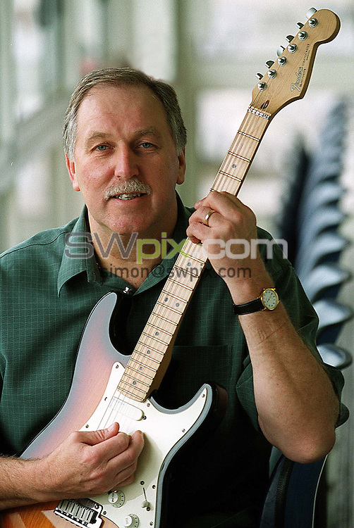 Pix: Simon/SWpix.com. Cricket. Yorkshire County Cricket Club. Playing staff. 09/12/2002. ..COPYRIGHT PICTURE>>SIMON WILKINSON>>01943 436649>>..Steve Oldham pictured with his prize fender guitar