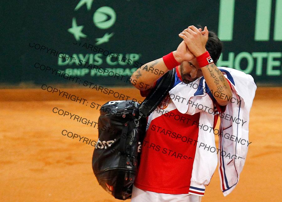 Tennis Tenis<br /> Davis Cup semifinal polufinale<br /> Serbia v Canada<br /> Janko Tipsarevic v Milos Raonic<br /> Janko Tipsarevic reacts<br /> Beograd, 13.09.2013.<br /> foto: Srdjan Stevanovic/Starsportphoto &copy;