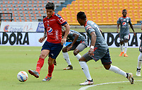 MEDELLÍN - COLOMBIA, 04-05-2018: German Cano (Der) jugador del Medellín disputa el balón con Ivan Velez (Izq) de America de Cali durante el partido entre Deportivo Independiente Medellín y America de Cali por la fecha 14 de la Liga Águila I 2018 jugado en el estadio Atanasio Girardot de la ciudad de Medellín. / German Cano (R) player of Medellin vies for the ball with Ivan Velez (L) player of America de Cali during match between Deportivo Independiente Medellin and America de Cali for the date 14 of the Aguila League I 2018 played at Atanasio Girardot stadium in Medellin city. Photo: VizzorImage / León Monsalve / Cont