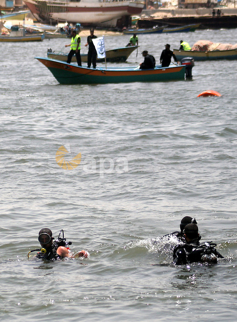 """Hamas marine security take to the open waters during a drill in preparation for the arrival of ships expected to break the Israeli naval blockade on the port in Gaza City on the coast of the Mediterranean Sea on May 26, 2010. Israel claimed a flotilla of pro-Palestinian activists seeking to bust the Gaza blockade is a provocation and that the aid it is carrying is """"unnecessary."""" Three cargo vessels left from Ireland, Greece and Turkey in recent days and plan to rendezvous with six smaller passenger boats off the coast of Cyprus before steaming on to Gaza where organisers hope to arrive by May 29. Photo by Ashraf Amra"""