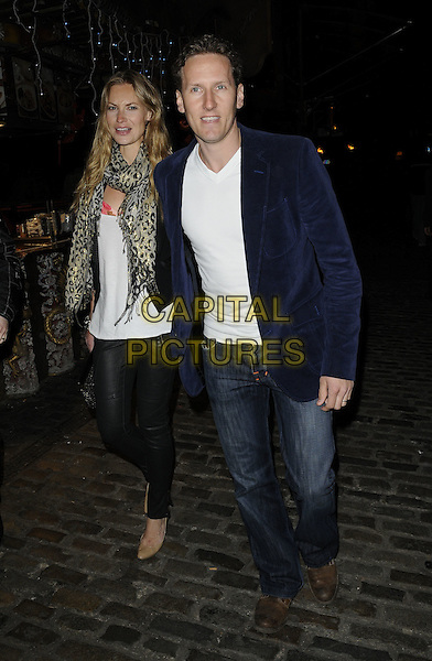 ZOE HOBBS & BRENDAN COLE.At Liz McClarnon's 30th Birthday Party, Shaka Zulu Bar & restaurant, the Stables Market, Chalk Farm Road, .London, England, UK, April 13th 2011..full length jeans blue navy jacket  print scarf couple husband wife  leopard animal  leather trousers pants white  t-shirt blazer .CAP/CAN.©Can Nguyen/Capital Pictures.