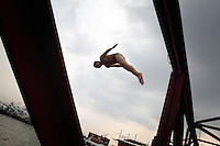 A man dives into Dongting Lake, Hunan Province. Dongting Lake has decreased in size in recent decades as a result of land reclamation and damming of the Yangtze. China. 2010