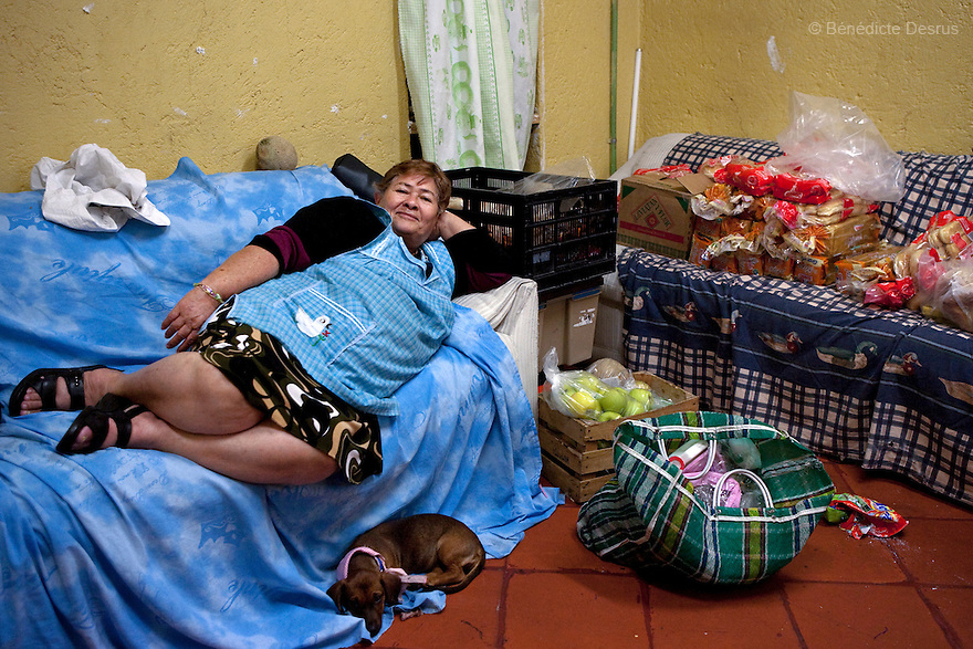 Laeticia, a cook at Casa Xochiquetzal, rests on the sofa after finishing her work at the shelter in Mexico City, Mexico on June 5, 2009. Casa Xochiquetzal is a shelter for elderly sex workers in Mexico City. It gives the women refuge, food, health services, a space to learn about their human rights and courses to help them rediscover their self-confidence and deal with traumatic aspects of their lives. Casa Xochiquetzal provides a space to age with dignity for a group of vulnerable women who are often invisible to society at large. It is the only such shelter existing in Latin America. Photo by Bénédicte Desrus