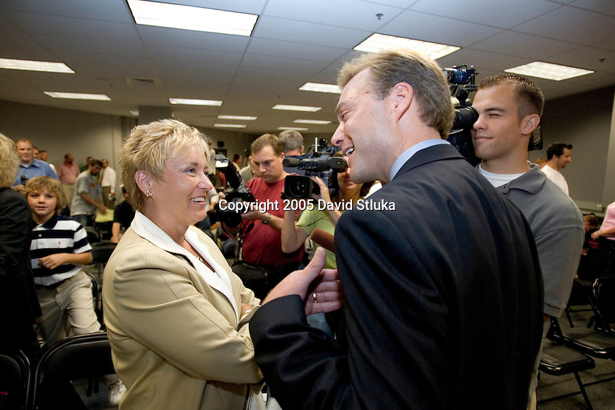 MADISON, WI - JULY 28:  Cindy Alvarez talks with media following the announcement that her husband Barry will retire as football coach at the end of the 2005 football season at the Kohl Center on July 28, 2005 in Madison, Wisconsin. Photo by David Stluka