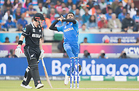 Hardik Pandya (India) in action as Henry Nicholls (New Zealand) backs up during India vs New Zealand, ICC World Cup Semi-Final Cricket at Old Trafford on 9th July 2019