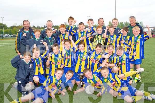 Killorglin AFC captain Ronan O'Shea and his team mates celebrate after the received the John Murphy memorial cup when they defeated Killarney Athletic in Killarney on Saturday