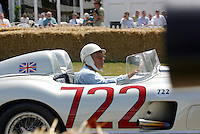 SIR STIRLING MOSS driving his 1955 Mercedes-Benz 300 SLR, Goodwood Festival of Speed 2003, 030711. Photo: Glyn Kirk/Action Plus...Driver drivers racing.Motor sport sports motorsport.motorcar cars .
