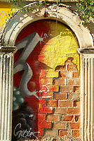 Mural on a brick wall framed by arch  in old Mazatlan, Sinaloa, Mexico