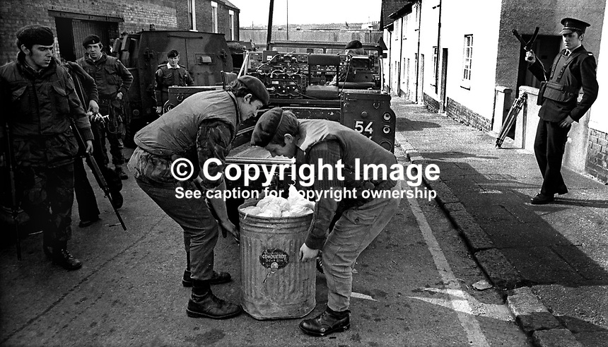 British soldiers take away up to 150 kgs of nitroglycerine discovered in a carpenter&rsquo;s workshop in Colinward Street, off Springfield Road, Belfast, N Ireland, 20th September 1972. 197209200570.<br />