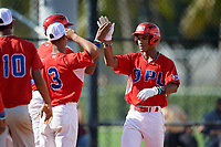 Gabriel Arias (1) high fives teammates after hitting a home run during the Dominican Prospect League Elite Florida Event at Pompano Beach Baseball Park on October 14, 2019 in Pompano beach, Florida.  (Mike Janes/Four Seam Images)