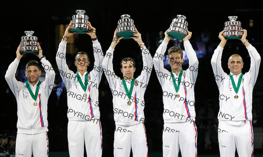BELGRADE, SERBIA - NOVEMBER 17: L-R Jan Hayek Lukas Rosol Radek Stepanek Tomas Berdych and  team captain Vladimir Safarik  of Czech Republic hold the winners trophy aloft after a 3-2 victory against Serbia during the award ceremony of the Davis Cup World Group Final between Serbia and Czech Republic at Kombank Arena on November 17, 2013 in Belgrade, Serbia. (Photo by Srdjan Stevanovic)