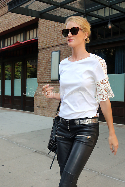 WWW.ACEPIXS.COM<br /> <br /> June 9 2015, New York City<br /> <br /> Model Rosie Huntington-Whiteley leaves a downtown hotel on June 9 2015 in New York City<br /> <br /> By Line: Philip Vaughan/ACE Pictures<br /> <br /> ACE Pictures, Inc.<br /> tel: 646 769 0430<br /> Email: info@acepixs.com<br /> www.acepixs.com
